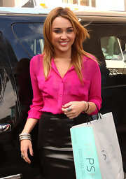 Miley Cyrus added some shimmer with a trio of silver bangles.
