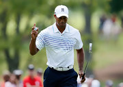 Tiger Woods chose this white polo with multi-colored stripes for his on-the-course look.