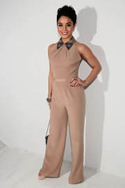 Vanessa Hudgens stuck to her '70s aesthetic in this nude jumpsuit at the Jenny Packham Fashion Show.