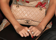 Lauren Conrad kept her look mostly neutral with this classic nude Chanel chain strap bag.