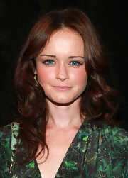 Alexis Bledel was all eyes at the Rebecca Minkoff Spring 2012 fashion show. Her bold, green dress helped bring out the blue of her eyes, but her shiny, auburn tresses really turned the focus on her face.