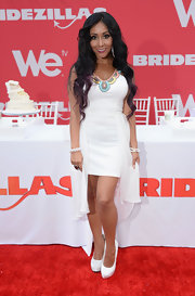 Nicole Polizzi chose an all-white look at the 'Bridezilla' cake-eating contest when she wore this white fishtail dress with a pastel embroidered neckline.