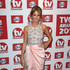 Millie Mackintosh Lookbook: Millie Mackintosh wearing Metallic Clutch (2 of 3). Millie Mackintosh carried a gold clutch to complete her look during the TV Choice Awards held in London.
