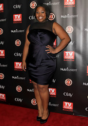 Amber Riley took a stylish turn on the red carpet in classic black satin pumps. The heels were the perfect complement to a black satin cocktail dress.