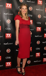 Jennifer Morrison charmed in strappy black heels she paired with a red cocktail dress. 40's style hair and makeup completed the glam look.