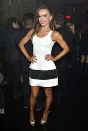 Karina Smirnoff showed off her super-fit physique in a sporty-chic black-and-white mini dress during the TV Guide Magazine Hot List Party.