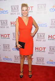 Kristen Johnston accessorized her fiery ensemble with black glittering sandals.
