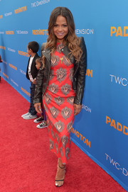 Christina Milian looked bold on the 'Paddington' premiere red carpet in a Dolce & Gabbana Sacred Heart print dress teamed with a black leather jacket.