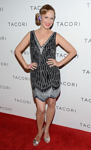 Melora looked like a flapper at the 'City Lights' event wearing this beaded shift dress with a V-neck.