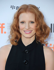 At the 'Take Shelter' premiere, Jessica Chastain wore her hair in soft, bouncy waves. To try her look, either set hair on hot rollers, or create waves by curing one-inch sections of hair with a medium-barreled curling iron.