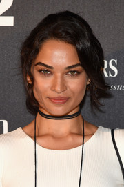 Shanina Shaik looked sweet wearing this loose ponytail with wavy tendrils while attending the Miami Beach kickoff party.