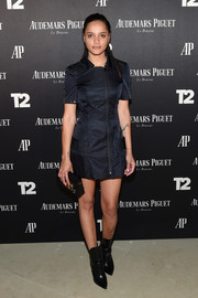 Sasha Lane teamed her dress with pointy black boots.