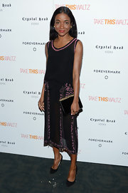 Genevieve Jones looked sweet in a black sheer tank dress with pink floral embroidery at the 'Take This Waltz' screening.