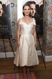 Elegant silver gladiator heels, also by Dior, polished off Natalie Portman's look.