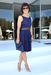 Constance Zimmer attended the relaunch of Tamara Mellon's namesake collection wearing a blue Rebecca Minkoff dress featuring a mesh midsection and geometric accents on the skirt.
