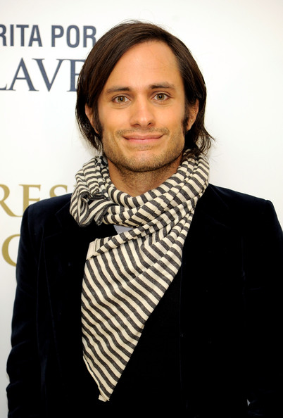 Gael wears a striped scarf for this ultra chic European style.
