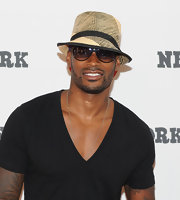 The model topped off his look with a two-toned straw hat.
