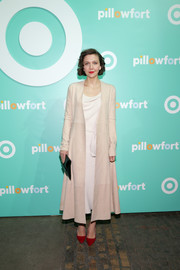 Maggie Gyllenhaal teamed a stylish nude suede coat with a little white dress for the Target Pillowfort launch party.