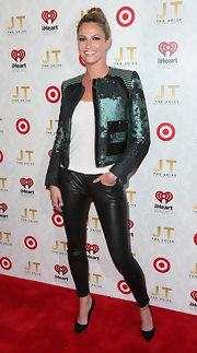 Erin Andrews chose a cool and funky teal motorcycle jacket for her red carpet look at the Justin Timberlake cd release party.
