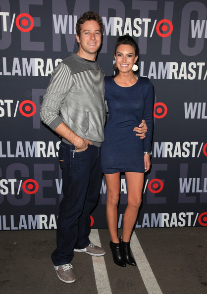 Elizabeth Chambers paired a darling sweater dress with black leather ankle boots.
