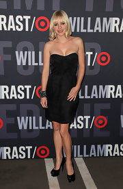 Anna wears a strapless LBD with black patent platform pumps.