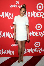 Chrissy Teigen worked a '60s vibe in a short white Victoria Beckham shift dress during the Target Wonderland VIP event.
