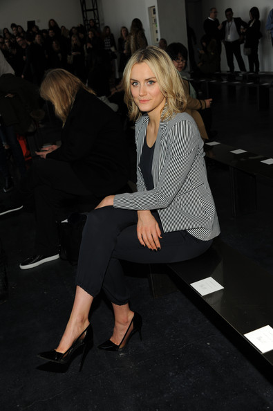 Taylor Schilling Pumps [fashion,leg,suit,blond,event,footwear,shoulder,joint,sitting,human body,taylor schilling,theory show,front row,new york city,spring studios,fashion show,mercedes-benz fashion week]