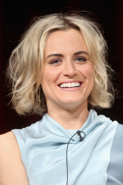 Taylor Schilling Messy Cut [orange is the new black,hair,face,blond,facial expression,chin,eyebrow,hairstyle,skin,head,smile,taylor schilling,portion,the beverly hilton hotel,beverly hills,california,netflix,summer tca,panel discussion,summer tca tour]