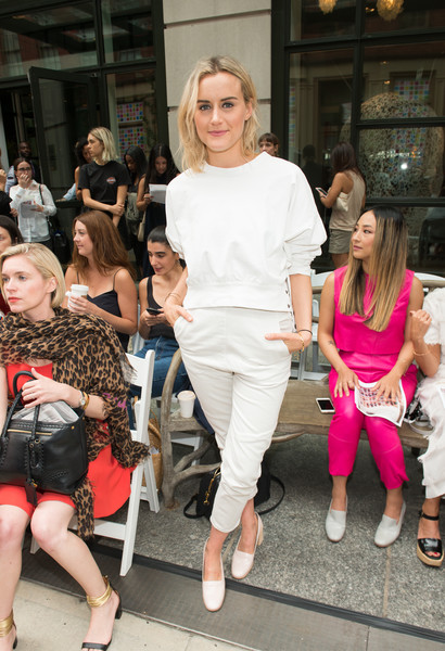 Taylor Schilling Crewneck Sweater [people,pink,street fashion,fashion,clothing,shoulder,lady,blond,snapshot,footwear,rachel comey,taylor schilling,front row,new york city,new york fashion week,fashion show]