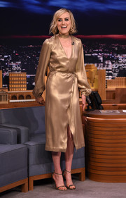 Taylor Schilling was a style star in this shimmery gold wrap dress by Georgine during her 'Jimmy Fallon' appearance.