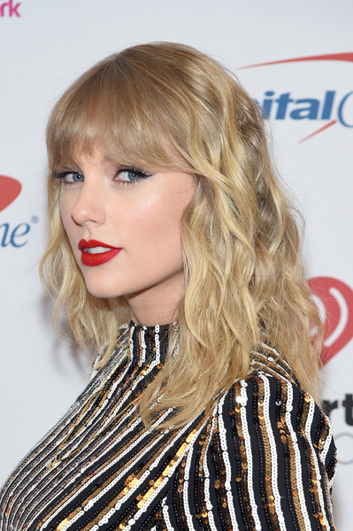 Taylor Swift Medium Wavy Cut with Bangs [hair,blond,hairstyle,face,lip,beauty,long hair,hair coloring,bangs,layered hair,hair,hair,hairstyle,style,face,lip,iheartradio,capital one,taylor swift,z100 jingle ball,taylor swift,jingle ball,celebrity,new york,iheartradio,image,style]