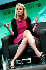 Marissa Mayer attended TechCrunch Disrupt NY 2014 wearing a black cardigan over a fuchsia dress.