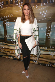 Catt Sadler attended the Ted Baker London SS'16 launch event rocking ripped black jeans and a white crop-top.