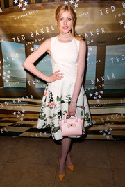 Katherine McNamara styled her dress with cute orange pumps.