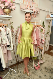 Bailee Madison looked darling in a chartreuse fit-and-flare cocktail dress with a bowed neckline at the Ted Baker London SS'18 launch.