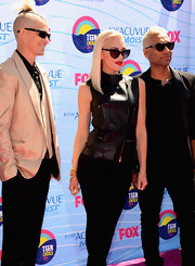 Gwen rocked a zip-up leather vest with her black ensemble and bright blond locks.
