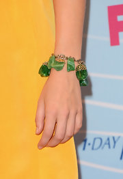 Candice Accola's jade bracelet provided a striking color contrast to her yellow dress at the 2012 Teen Choice Awards.