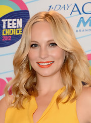 Orange lipstick, coupled with a yellow dress, totally brightened up Candice Accola's look during the 2012 Teen Choice Awards.