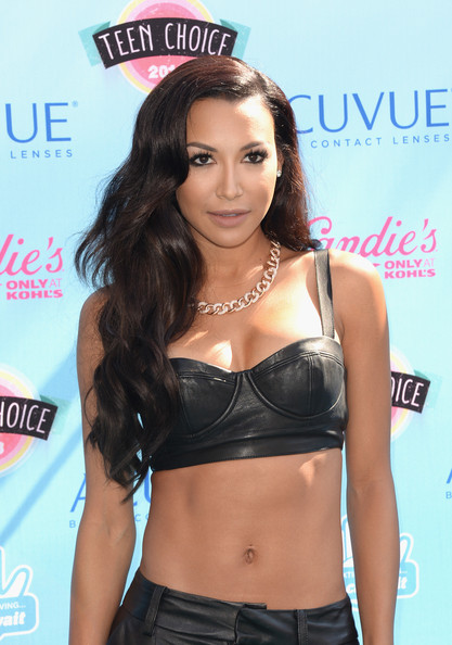 Naya's long chocolate waves were a super sexy touch for the star.