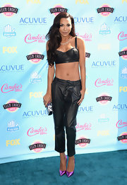 Naya chose a black leather bustier crop top to show off her toned tummy.