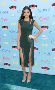 Selena went classic and chic in a forest green cutout dress with thigh-high slits.
