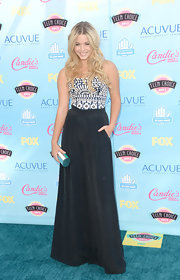 Sasha's navy top featured geometric embellishments for a pretty touch on the blue carpet.