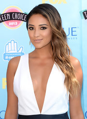 Shay Mitchell pulled back her ombre waves into a glam side sweep.