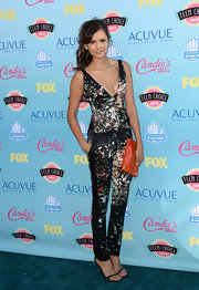 Nina showed her wild side with this pain-splatter print top and matching trousers at the 2013 Teen Choice Awards.