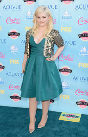 Abigail looked lovely in a retro-inspired turquoise dress that featured a full skirt and deep V-neck.