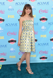 Joey King looked simply mod-chic in this playful lime green printed dress with embellishments on the bust and waist.