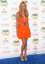 Cat Deeley looked like the goddess of summer in a flower-accented, deep-V orange mini dress by Alberta Ferretti during the Teen Choice Awards.