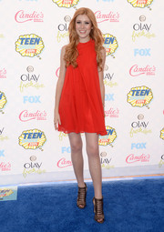 Katherine McNamara teamed her mini with edgy-chic brown gladiator heels, also by BCBGeneration.