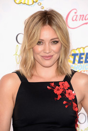Hilary Duff looked hip and edgy with her wispy layers at the Teen Choice Awards.