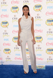 Opting for a white-on-white look, Kendall Jenner teamed her top with a pair of Oriett Domenech slacks featuring sheer side panels.